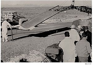 SL-1 - The stretcher rig. Army volunteers from a special Chemical Radiological Unit at Dugway Proving Ground practiced before a crane inserted the rig into the SL-1 reactor building to collect the body of the man impaled to the ceiling directly above the reactor vessel.