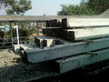 Sleeper rails being transported at Simhachalam Train Station 02.jpg