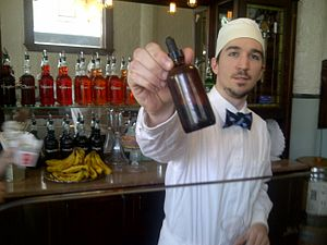 Phosphate soda - A soda jerk at Franklin Fountain in Philadelphia holds up his phosphate bottle.