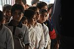 Soldiers, Iraqi national policemen distribute school supplies in Baghdad DVIDS157248.jpg