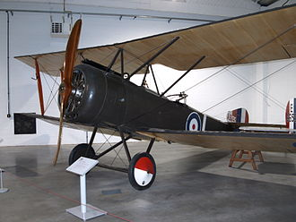 "Sopwith 1½ Strutter - A preserved Sopwith 1½ Strutter at the RAF Museum, London, showing the W-form pairs of ""1½"" struts that gave the aeroplane its name, and the centrally-mounted Vickers machine gun"