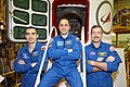 Soyuz TMA-22 crew in front of their spacecraft.jpg