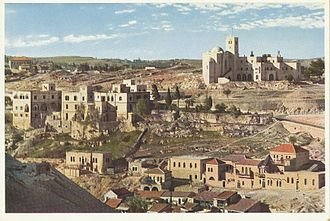 Saint John Eye Hospital Group - Panoramic view of the hospital and St Andrew's Church in 1930