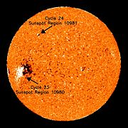 Last sunspot of cycle 23 (equator) and first sunspot of cycle 24 (top).