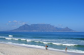 Table Mountain - View of Table Mountain and Cape Town seen from Bloubergstrand. Table Mountain is flanked by Devil's Peak on the left and Lion's Head on the right.