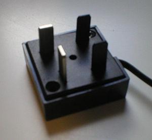 Telebrás plug - A Telebrás plug with two metal pins and two plastic pins.