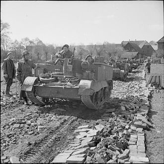 159th Infantry Brigade (United Kingdom) - Universal Carriers of the 1st Battalion, Herefordshire Regiment's anti-tank platoon move up towards the Weser bridgehead, 7 April 1945.