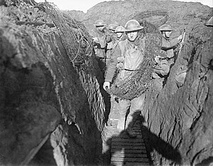 York and Lancaster Regiment - Men of the York and Lancaster Regiment, probably 2/4th Battalion, part of 187th Brigade, take up wire for use by a night working party on the 62nd Division front between Oppy and Gavrelle, 13th January 1918.