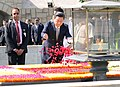 The Chinese President, Mr. Xi Jinping paying floral tributes at the Samadhi of Mahatma Gandhi, at Rajghat, in Delhi on September 18, 2014.jpg
