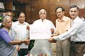 The Indian Railway Finance Corporation (IRFC) officials paying Annual dividend cheque of Rs.110 crores for the financial year 2003-2004 to the Union Minister for Railways Shri Lalu Prasad in New Delhi on October 05, 2004.jpg