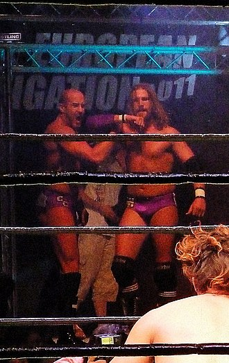 The Kings of Wrestling - Claudio Castagnoli and Chris Hero performing their signature pose after winning on Pro Wrestling Noah's European Navigation Tour