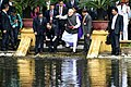 The Prime Minister, Shri Narendra Modi and the Prime Minister of the Socialist Republic of Vietnam, Mr. Nguyen Xuan Phuc feed fish in Uncle Ho's pond, in the Presidential Place Compound, in Hanoi, Vietnam (1).jpg