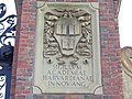 The Seal of Harvard College as inscribed on the top of the Entrance into the Main Campus of Harvard College..JPG