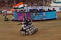 The dare devil stunts of mobike riders with the National Flag at the opening ceremony of 3rd Commonwealth Youth Games-2008, in Pune on October 12, 2008.jpg