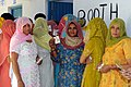 The women voters showing their voter identity card, standing in a queue to cast their vote at a polling booth of Khari village in Sonipat, Haryana during the 4th Phase of General Election-2009 on May 07, 2009.jpg