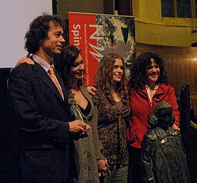 Theo Rasing accepts his Spinoza Award with his wife & daughters.jpg
