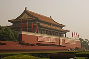 Tiananmen Gate -- the Gate of Heavenly Peace, the most famous part of the Forbidden City. Complete with portrait of Chairman Mao and appropriate propaganda.jpg