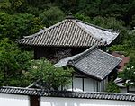 Wooden building with pyramid shaped roof.