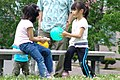 Two kids playing by rubber balls; 2008.jpg