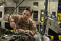 U.S. Air Force Staff Sgt. Alicia Clark, an aeromedical technician with the 379th Expeditionary Aeromedical Evacuation Squadron, attaches an oxygen line before an aeromedical evacuation aboard a C-17 Globemaster 131209-F-AM664-056.jpg