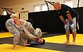 U.S. Army 1st Sgt. Daniel Perry, a combatives instructor and first sergeant with Headquarters and Headquarters Company, 223rd Regiment Regional Training Institute, officiates over a match between Spc. Cameron 130913-Z-IB797-019.jpg