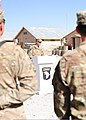 U.S. Army Sgt. 1st Class Gregory Funk, center, the noncommissioned officer in charge of Forward Operating Base (FOB) Lightning Base Defense Operations Center with the 4th Battalion, 320th Field Artillery 130606-Z-HL120-026.jpg