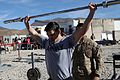 U.S. Army Sgt. Christopher Munoz, with Foxtrot Company, 2nd Battalion, 506th Infantry Regiment, 4th Brigade Combat Team, 101st Airborne Division, performs overhead squats with a 45-pound bar during the Winter 131213-A-YW808-163.jpg