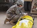 U.S. Army Spc. Kathy Hysong applies a bag valve mask to assist a simulated casualty with breathing during an exercise at the Troop Medical Clinic, Contingency Operating Base Warhorse, Iraq, June 6, 2011 110606-A-XX999-001.jpg