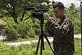 U.S. Marine Corps Pfc. Joshua E. Chacon, a combat videographer with Marine Corps Installations Pacific Combat Camera, documents Marines with Combat Logistics Regiment 35, 3rd Marine Logistics Group beginning 140925-M-RN526-024.jpg