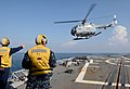 U.S. Navy Boatswain's Mate 3rd Class Matthew Fountain, left, and Boatswain's Mate 2nd Class Carlos Medina guide an Indonesian navy Bo105 helicopter during flight operations aboard the guided missile destroyer 130524-N-YU572-159.jpg