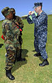 U.S. Navy Lt. j.g. Nicholas Edmiston, right, demonstrates punching techniques for members of the Royal Barbados Defense Force participating in intensity drills during the Marine Corps Martial Arts Program 100823-N-EP471-739.jpg
