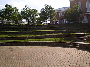 Adele H. Stamp Student Union - The Nyumburu Amphitheater hosts numerous outdoor performances, and is located immediately next to Stamp (seen in background).