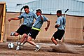 US Army 52940 CAMP TAJI, Iraq-Players from 4th Battalion and the 615th Aviation Support Battalion, both of the 1st Air Cavalry Brigade, 1st Cavalry Division,attempt to win the ball during a scrimmage game, Oct.10,.jpg