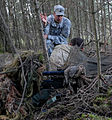 US Army Special Forces MSgt gives instruction to two sniper students.jpg