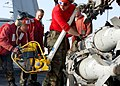 US Navy 030305-N-8693O-002 Aviation ordnancemen load a bomb.jpg