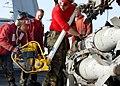 US Navy 030305-N-8693O-002 Aviation ordnancemen load a bomb.jpg