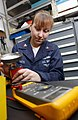 US Navy 030307-N-4953E-034 Information Systems Technician 2nd Class Colleen White does preventative maintenance on battle lantern lights aboard USS Harry S. Truman (CVN 75).jpg