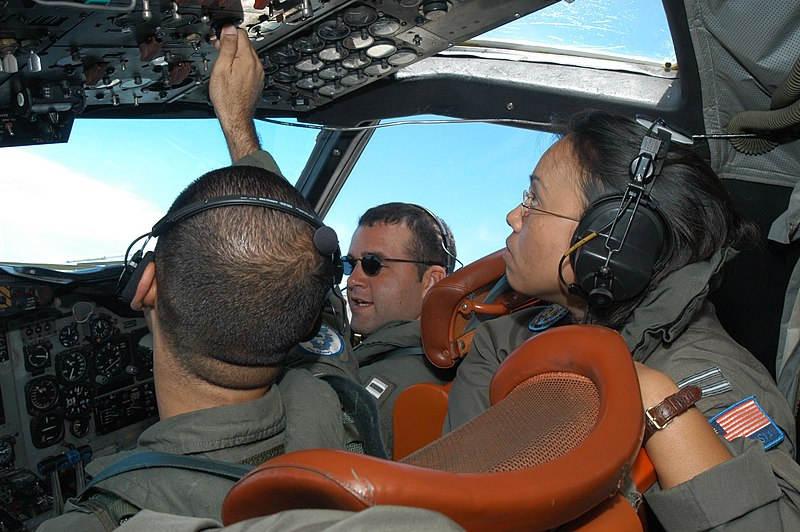 File:US Navy 030727-N-5770O-008 P-3C Orion flight engineer Aviation Machinist's Mate 2nd Class Alex Michelen, left, assigned to Patrol Squadron Four (VP-4) makes adjustments during a familiarization flight for Royal Malaysian Air F.jpg