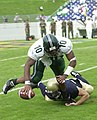 US Navy 030920-N-9693M-001 Navy sophomore line backer Evan Beard sacks Eastrern Michigan University (EMU) quarterback Chinedu Okoro.jpg