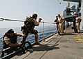 US Navy 040722-N-4374S-015 Commander, Destroyer Squadron Two Four (COMDESRON 24), Capt. Anthony Kurta and Lt. Shane Crockett, observe the boarding procedures demonstrated by the British Royal Marines aboard the frigate HMS Some.jpg