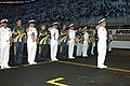 US Navy 040827-N-3242C-002 Commander, Navy Recruiting Command, Read Adm. Jeffrey L. Fowler, leads the Navy party during the National Anthem at the Busch Series, Food City 250, race held at Bristol Motor Speedway.jpg