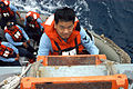 US Navy 050109-N-5039H-012 Information Technology Specialist 3rd Class Christopher Pang, assigned to the reserve detachment aboard USS Crommelin (FFG 37), disembarks the guide missile frigate.jpg