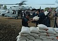 US Navy 050116-N-8629M-001 Volunteer workers from USS Abraham Lincoln Carrier Group fill an MH-60S Knighthawk with relief supplies.jpg