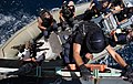US Navy 050626-N-0905V-055 Sailors assigned the boarding team aboard the guided missile cruiser USS Antietam (CG 54), lower themselves to the starboard Rigid Hull Inflatable Boat.jpg