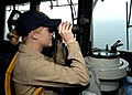 US Navy 050717-N-5526M-008 Ens. Jessica Pommgrer scans the horizon for surface contacts aboard the Whidbey Island-class amphibious dock landing ship USS Gunston Hall (LSD 44).jpg