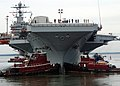 US Navy 050830-N-5188B-022 Two tug boats steady the bow of the Nimitz Class aircraft carrier USS George Washington (CVN 73) as the nuclear-powered ship transits from the dry dock.jpg