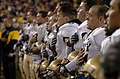 US Navy 051203-N-0295M-022 U.S. Naval Academy Midshipmen team sing their Alma Mater following a 42-23 win over the Black Knights of Army, at the 106th playing of Army vs. Navy Football game.jpg