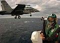 US Navy 051207-N-3488C-032 Photographer's Mate 2nd Class Gregory Mitchell videotapes flight deck operations as an F-A-18F Super Hornet launches off the flight deck.jpg