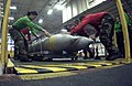 US Navy 060208-N-8158F-046 Sailors reposition a palette of 2000 pound general-purpose bombs BLU-109 in preparation for transportation during a weapons offload.jpg