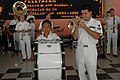 US Navy 060814-N-1577S-071 Navy Musician 2nd Class Brandon Barbie, with the U.S. Navy Show Band, performs a solo for students at SMB-1 Jr. High School during the Military Sealift Command (MSC) hospital ship USNS Mercy's (.jpg